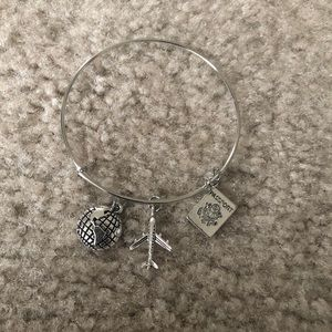 Silver bangle with travel charms